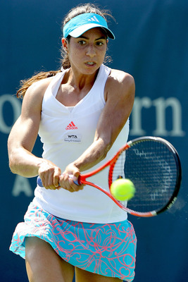 MASON, OH - AUGUST 17:  Christina McHale of USA returns a shot to Caroline Wozniacki of Denmark during the Western & Southern Open at the Lindner Family Tennis Center on August 17, 2011 in Mason, Ohio.  (Photo by Matthew Stockman/Getty Images)