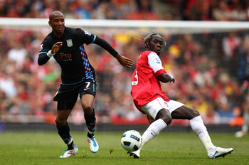 LONDON, ENGLAND - MAY 15:  Bacary Sagna (R) of Arsenal in action against Ashley Young of Aston Villa during the Barclays Premier League match between Arsenal and Aston Villa at the Emirates Stadium on May 15, 2011 in London, England.  (Photo by Richard He