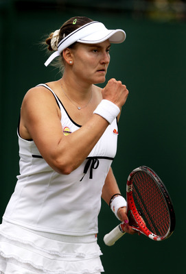 LONDON, ENGLAND - JUNE 24:  Nadia Petrova of Russia reacts to a play during her third round match against Kateryna Bondarenko of Ukraine on Day Five of the Wimbledon Lawn Tennis Championships at the All England Lawn Tennis and Croquet Club on June 24, 201
