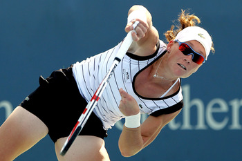 MASON, OH - AUGUST 16: Samantha Stosur of Australia serves to Eleni Daniilidou of Greece during the Western & Southern Open at the  Lindner Family Tennis Center on August 16, 2011 in Mason, Ohio.  (Photo by Matthew Stockman/Getty Images)