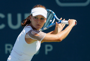 CARLSBAD, CA - AUGUST 07:  Agnieszka Radwanska of Poland prepares to return a backhand to Vera Zvonareva of Russia during the final of the Mercury Insurance Open presented by Tri-City Medical at the La Costa Resort and Spa on August 7, 2011 in Carlsbad, C