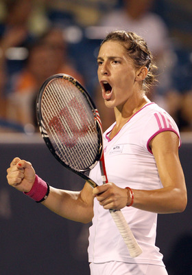 MASON, OH - AUGUST 20:  Andrea Petkovic of Germany celebrates a point win in the first set against Jelena Jankovic of Serbia during the Western & Southern Open at the Lindner Family Tennis Center on August 20, 2011 in Mason, Ohio.  (Photo by Elsa/Getty Im