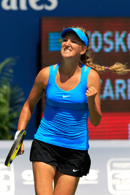 TORONTO, ON - AUGUST 12: Victoria Azarenka of Belarus celebrates match point against Galina Voskoboeva of Kazakhstan on Day 5 of the Rogers Cup presented by National Bank at the Rexall Centre on August 12, 2011 in Toronto, Ontario, Canada.  (Photo by Chri