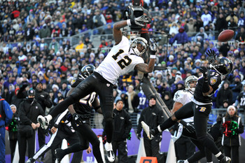 BALTIMORE, MD - DECEMBER 19:  Marques Colston #12 of the New Orleans Saints goes up for a ball that was caught by Lance Moore #16 during the game against the Baltimore Ravens  at M&T Bank Stadium on December 19, 2010 in Baltimore, Maryland. The Ravens def