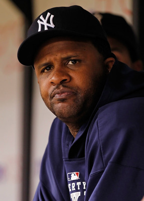 ST. PETERSBURG, FL - JULY 18:  Pitcher C.C. Sabathia #52 of the New York Yankees watches his team from the dugout against the Tampa Bay Rays during the game at Tropicana Field on July 18, 2011 in St. Petersburg, Florida.  (Photo by J. Meric/Getty Images)