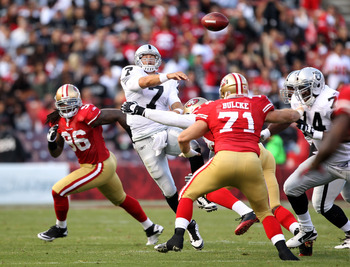 SAN FRANCISCO, CA - AUGUST 20:  Kyle Boller #7 of the Oakland Raiders is hit while passing the ball against the San Francisco 49ers at Candlestick Park on August 20, 2011 in San Francisco, California.  (Photo by Ezra Shaw/Getty Images)