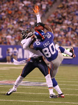 EAST RUTHERFORD, NJ - AUGUST 22:  Victor Cruz #80 of the New York Giants makes a catch against D.J. Moore #30 of the Chicago Bears during their pre season game on August 22, 2011 at The New Meadowlands Stadium in East Rutherford, New Jersey.  (Photo by Al