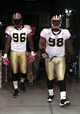 GLENDALE, AZ - OCTOBER 10:  Alex Brown #96 and Sedrick Ellis #98 of the New Orleans Saints walk out onto the field before the NFL game against the Arizona Cardinals at the University of Phoenix Stadium on October 10, 2010 in Glendale, Arizona.  (Photo by