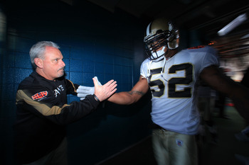 MIAMI GARDENS, FL - FEBRUARY 07: Assistant Head Coach Joe Vitt high fives in the tunnel with #52 Jonathan Casillas of the New Orleans Saints prior to Super Bowl XLIV against the Indianapolis Colts on February 7, 2010 at Sun Life Stadium in Miami Gardens,
