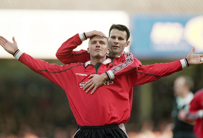 18 Mar 2000:  David Beckham of Manchester United is congratulated by teammate Ryan Giggs after scoring during the FA Carling Premiership match against Leicester City at Filbert Street in Leicester, England.  Manchester United won the match 2-0. \ Mandator