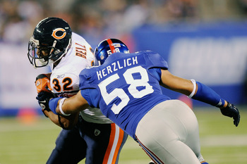 EAST RUTHERFORD, NJ - AUGUST 22:  Mark Herzlich #58 of the New York Giants tackles Kahlil Bell #32 of the of the Chicago Bears during a pre season game at New Meadowlands Stadium on August 22, 2011 in East Rutherford, New Jersey.  (Photo by Patrick McDerm