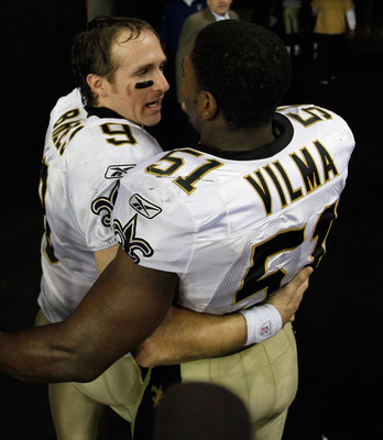 ATLANTA, GA - DECEMBER 27:  Quarterback Drew Brees #9 of the New Orleans Saints celebrates with Jonathan Vilma #51 after defeating the Atlanta Falcons 17-14 at the Georgia Dome on December 27, 2010 in Atlanta, Georgia.  (Photo by Kevin C. Cox/Getty Images