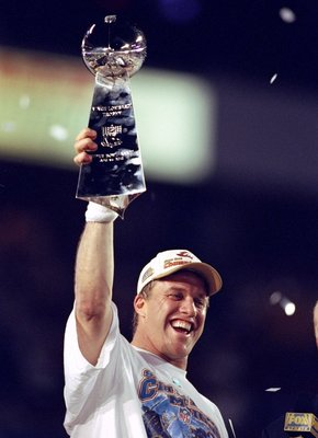 31 Jan 1999: Quarterback John Elway #7 of the Denver Broncos holds up the Vince Lombardi trophy after defeating the Atanta Falcons to win Super Bowl XXXIII at Pro Player Stadium in Miami, Florida. The Broncos defeated the Falcons 34-19 to win their second