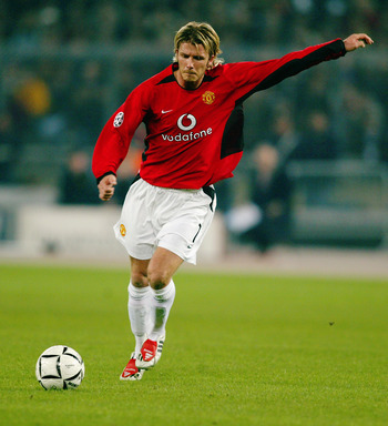 TURIN - FEBRUARY 25:  David Beckham of Manchester United takes a free-kick during the UEFA Champions League Second Phase Group D match between Juventus and Manchester United held on February 25, 2003 at the Stadio Delle Alpi, in Turin, Italy. Manchester U