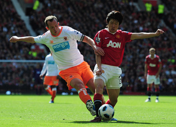 Charlie Adam battles Park Ji-Sung of Manchester United