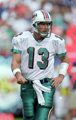 5 Dec 1999: Dan Marino #13 of the Miami Dolphins struts on the field during the game against the Indianapolis Colts at the Pro Player Stadium in Miami, Florida. The Colts defeated the Dolphins 37-34. Mandatory Credit: Eliot J. Schechter  /Allsport