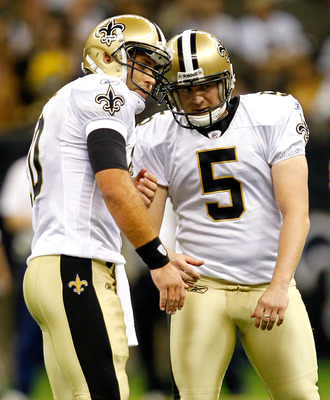 NEW ORLEANS, LA - AUGUST 12: Garret Hartley # 5 and Chase Dainel #10 of the New Orleans Saints celebrate after kicking a field goal against the San Francisco 49ers during their pre season game at Louisiana Superdome on August 12, 2011 in New Orleans, Loui