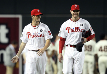 PHOENIX, AZ - JULY 12:  National League All-Star Cole Hamels #35 of the Philadelphia Phillies and National League All-Star Roy Halladay #34 of the Philadelphia Phillies talk during batting practice before the start of the 82nd MLB All-Star Game at Chase F
