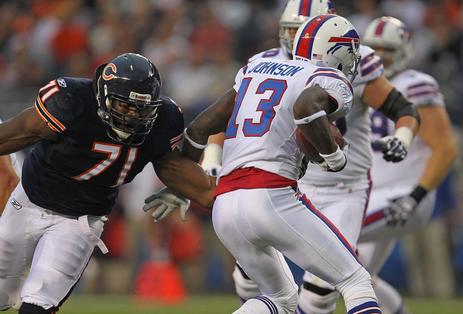 CHICAGO, IL - AUGUST 13:  Israel Idonije #71 of the Chicago Bears moves to tackle Stevie Johnson #13 of the Buffalo Bills during a preseason game at Soldier Field on August 13, 2011 in Chicago, Illinois. The Bears defeated the Bills 10-3.  (Photo by Jonat