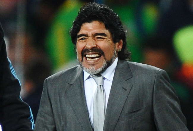 JOHANNESBURG, SOUTH AFRICA - JUNE 27:  Diego Maradona head coach of Argentina celebrates victory and progress to the quarter finals in the 2010 FIFA World Cup South Africa Round of Sixteen match between Argentina and Mexico at Soccer City Stadium on June
