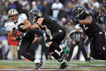 BALTIMORE, MD - DECEMBER 19:  Lance Moore #16 of the New Orleans Saints is tackled by Haruki Nakamura #43 of the Baltimore Ravens  at M&T Bank Stadium on December 19, 2010 in Baltimore, Maryland. The Ravens defeated the Saints 30-24. (Photo by Larry Frenc