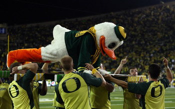 EUGENE, OR - OCTOBER 21:  The Oregon Duck mascot does push ups after a touchdown against the UCLA Bruins  on October 21, 2010 at the Autzen Stadium in Eugene, Oregon.  (Photo by Jonathan Ferrey/Getty Images)