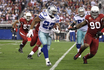 GLENDALE, AZ - DECEMBER 25:  Runningback Tashard Choice #23 of the Dallas Cowboys rushes the football against the Arizona Cardinals during the NFL game at the University of Phoenix Stadium on December 25, 2010 in Glendale, Arizona.  The Cardinals defeated