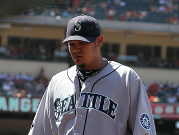 ANAHEIM, CA - AUGUST 07: Starting pitcher Felix Hernandez #34 of the Seattle Mariners walks off the field after finishing eight innings of work against the Los Angeles Angels of Anaheim on August 7, 2011 at Angel Stadium in Anaheim, California.  (Photo by