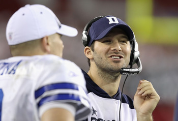 GLENDALE, AZ - DECEMBER 25:  Quarterbacks Tony Romo and Jon Kitna #3 of the Dallas Cowboys talk on the sideline during the NFL game against the Arizona Cardinals at the University of Phoenix Stadium on December 25, 2010 in Glendale, Arizona. The Cardinals