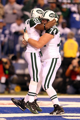 INDIANAPOLIS, IN - JANUARY 08:  LaDainian Tomlinson #21 of the New York Jets celebrates with Nick Magold #74 after Tomlnson scored a 1-yard touchdown in the fourth quarter against the Indianapolis Colts during their 2011 AFC wild card playoff game at Luca