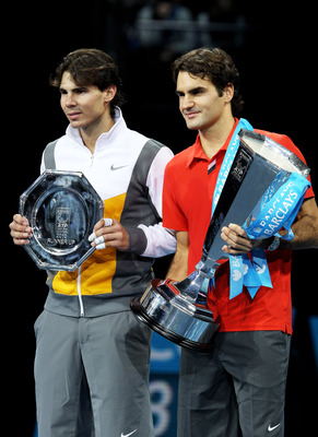 LONDON, ENGLAND - NOVEMBER 28:  Roger Federer (R) of Switzerland poses with the winners trophy and Rafael Nadal of Spain after their men's final match during the ATP World Tour Finals at O2 Arena on November 28, 2010 in London, England.  (Photo by Clive B