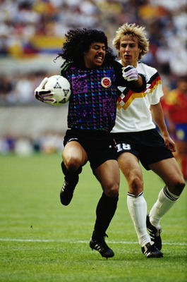 19 Jun 1990:  Rene Higuita of Columbia shields the ball from Jurgen Klinsman of West Germany during the World Cup match in Bologna, Italy. The match ended in a 1-1 draw.  \ Mandatory Credit: David  Cannon/Allsport