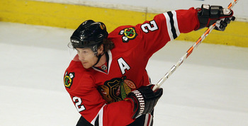 CHICAGO, IL - APRIL 17: Duncan Keith #2 of the Chicago Blackhawks winds up to shoot a power-play goal in the 1st period against the Vancouver Canucks in Game Three of the Western Conference Quarterfinals during the 2011 NHL Stanley Cup Playoffs at the Uni
