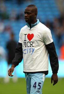 MANCHESTER, ENGLAND - AUGUST 15:  Mario Balotelli of Manchester City warms up in a 'L love Manchester' T-shirt prior to the Barclays Premier League match between Manchester City and Swansea City at Etihad Stadium on August 15, 2011 in Manchester, England.
