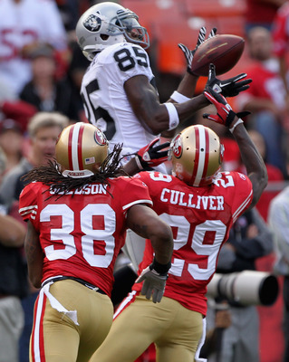 SAN FRANCISCO, CA - AUGUST 20:  Darrius Heyward-Bey #85 of the Oakland Raiders catches the ball while covered by Dashon Goldson #38 and Chris Culliver #29 of the San Francisco 49ers at Candlestick Park on August 20, 2011 in San Francisco, California.  (Ph