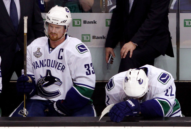 BOSTON, MA - JUNE 13:  Henrik Sedin #33 and Daniel Sedin #22 of the Vancouver Canucks sit on the bench during Game Six against the Boston Bruins in the 2011 NHL Stanley Cup Final at TD Garden on June 13, 2011 in Boston, Massachusetts.  (Photo by Bruce Ben