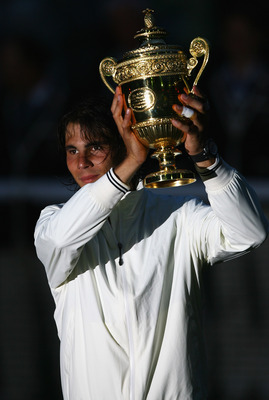 LONDON - JULY 06:  Rafael Nadal of Spain lifts the trophy after defeating Roger Federer of Switzerland in five sets in the final on day thirteen of the Wimbledon Lawn Tennis Championships at the All England Lawn Tennis and Croquet Club on July 6, 2008 in