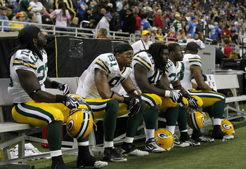 DETROIT - DECEMBER 12: Dimitri Nance #23, Andrew Quarless #81, Quinn Johnson #45 and Pat Lee #22 of the Green Bay Packers sit on the bench after their 7-3 loss to the Detroit Lions at Ford Field on December 12, 2010 in Detroit, Michigan.  (Photo by Leon H