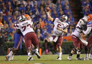 GAINESVILLE, FL - NOVEMBER 13:  Stephen Garcia #5 of the South Carolina Gamecocks passes during a game against the Florida Gators at Ben Hill Griffin Stadium on November 13, 2010 in Gainesville, Florida.  (Photo by Mike Ehrmann/Getty Images)