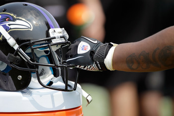 OWINGS MILLS, MD - JULY 29: Running back Ray Rice #27 of the Baltimore Ravens holds his helmet during training camp on July 29, 2011 in Owings Mills, Maryland.  (Photo by Rob Carr/Getty Images)