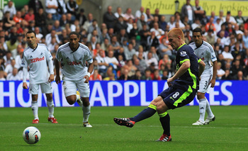 SWANSEA, WALES - AUGUST 20:  Ben Watson of Wigan takes a penalty kick, which is saved by Michael Vorm of Swansea City during the Barclays Premier League match between Swansea City and Wigan Athletic at Liberty Stadium on August 20, 2011 in Swansea, Wales.
