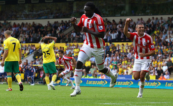 NORWICH, ENGLAND - AUGUST 21:  Kenwyne Jones of Stoke celebrates scoring the equalising goal in the last minute during the Barclay's premier league match between Norwich and Stoke City at Carrow Road on August 21, 2011 in Norwich, England.  (Photo by Juli