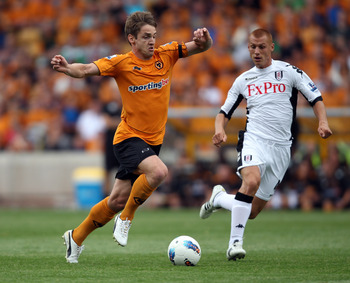 WOLVERHAMPTON, ENGLAND - AUGUST 21:  Kevin Doyle of Wolves is challenged by Steven Sidwell of Fulham during the Barclays Premier League match between Wolverhampton Wanderers and Fulham at Molineux on August 21, 2011 in Wolverhampton, England.  (Photo by R