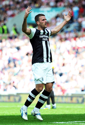 SUNDERLAND, ENGLAND - AUGUST 20:  Ryan Taylor of Newcastle United celebrates scoring the opening goal during the Barclays Premier League match between Sunderland and Newcastle United at Stadium of Light on August 20, 2011 in Sunderland, England.  (Photo b