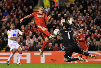 LIVERPOOL, ENGLAND - MARCH 17:  Martin Skrtel of Liverpool has a shot saved by Artur Moraes of SC Braga during the UEFA Europa League Round of 16 second leg match between Liverpool and SC Braga at Anfield on March 17, 2011 in Liverpool, England.  (Photo b