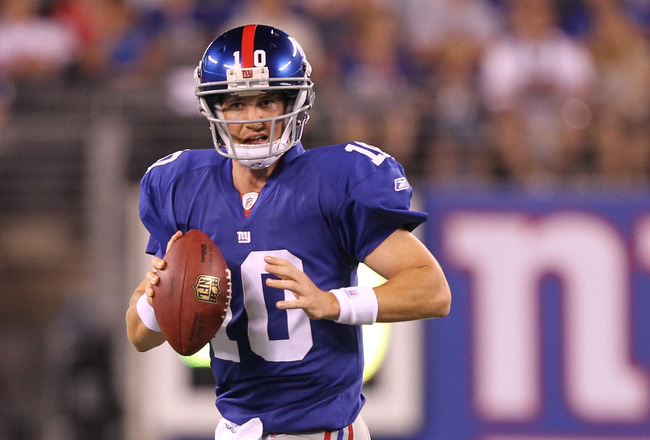 EAST RUTHERFORD, NJ - AUGUST 22:  Eli Manning #10 of the New York Giants looks to pass against the Chicago Bears during their pre season game on August 22, 2011 at The New Meadowlands Stadium in East Rutherford, New Jersey.  (Photo by Al Bello/Getty Image