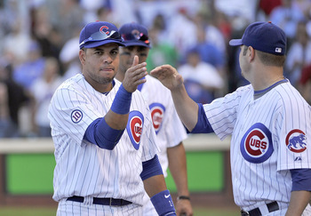 CHICAGO, IL - AUGUST 20:  Aramis Ramirez #16 (L) and John Grabow #43 of the Chicago Cubs celebrate their 3-0 win over the St. Louis Cardinals at Wrigley Field on August 20, 2011 in Chicago, Illinois.  (Photo by Brian Kersey/Getty Images)