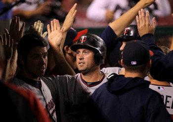 ANAHEIM, CA - AUGUST 03:  Michael Cuddyer #5 of the Minnesota Twins celebrates wtih teammates in the dugout after his grand slam home run in the fifth inning against the Los Angeles Angels of Anaheim on August 3, 2011 at Angel Stadium in Anaheim, Californ
