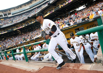PITTSBURGH - AUGUST 01:  Derrek Lee #25 of the Pittsburgh Pirates, newly acquired by trade from the Baltimore Orioles, runs out of the dugout during the game against the Chicago Cubs on August 1, 2011 at PNC Park in Pittsburgh, Pennsylvania.  (Photo by Ja