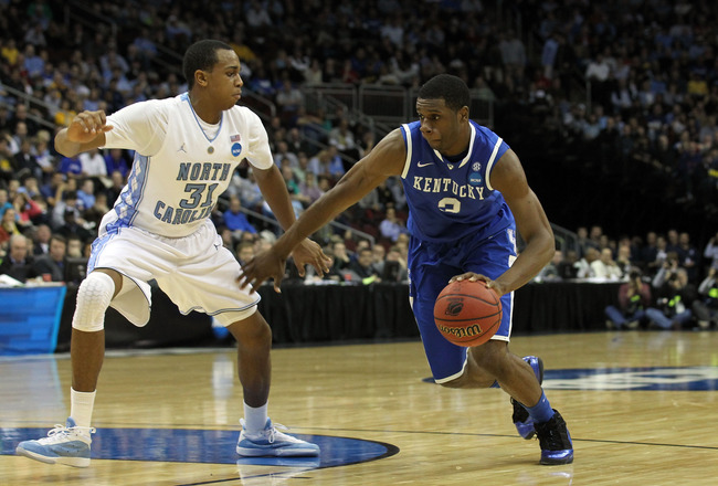 NEWARK, NJ - MARCH 27:  Terrence Jones #3 of the Kentucky Wildcats dribbles the ball against John Henson #31 of the North Carolina Tar Heels during the first half ofthe east regional final of the 2011 NCAA men's basketball tournament at Prudential Center